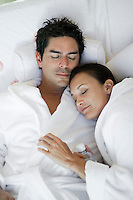 Couple sleeping in bathrobes