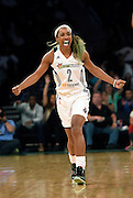 New York Liberty guard Candice Wiggins (2) celebrates after making a three-point basket against the Washington Mystics in the second half of a WNBA Eastern Conference basketball playoff series, Tuesday, Sept. 22, 2015 in New York. Liberty won 79-74. (AP Photo/Kathy Kmonicek)