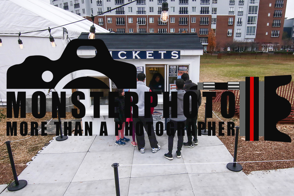 Customers buying tickets Friday. Nov. 25, 2016, at the Horizon Services Riverfront Rink at ConstitutionYard Beer Garden in Wilmington.