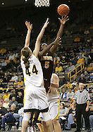 25 JANUARY 2007: Minnesota guard Korinne Campbell (5) shoots around Iowa center Megan Skouby (44) in Iowa's 80-78 overtime loss to Minnesota at Carver-Hawkeye Arena in Iowa City, Iowa on January 25, 2007.