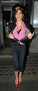 22.OCTOBER.2009. LONDON<br /> <br /> POP DIVA AMY WINEHOUSE SEEN LEAVING THE FISHWORKS RESTAURANT IN MARYLEBONE AT 9.30PM AND IS OBVIOUSLY STILL FEELING PROUD OF HER NEW BOOBS BECAUSE AS SOON AS SHE WALKED OUT THE RESTAURANT SHE UNDID HER JACKET AND SHIRT TO SHOW OFF HER CLEAVAGE, SHE THEN WENT ONTO HER FAVOURITE PUB THE HAWLEY ARMS IN CAMDEN WITH GOOD FRIEND TYLER JAMES. SHE STAYED AT THE HAWLEY TILL 11.30PM AND LEFT SUCKING ON A LOLLY WHILST SHOUTING OUT 'BLAKE'S GIRL' AND POINTING TO HER SHIRT WHICH SAYS BLAKE'S GIRL. <br /> <br /> BYLINE: EDBIMAGEARCHIVE.COM<br /> <br /> *THIS IMAGE IS STRICTLY FOR UK NEWSPAPERS AND MAGAZINES ONLY*<br /> *FOR WORLD WIDE SALES AND WEB USE PLEASE CONTACT EDBIMAGEARCHIVE - 0208 954 5968*