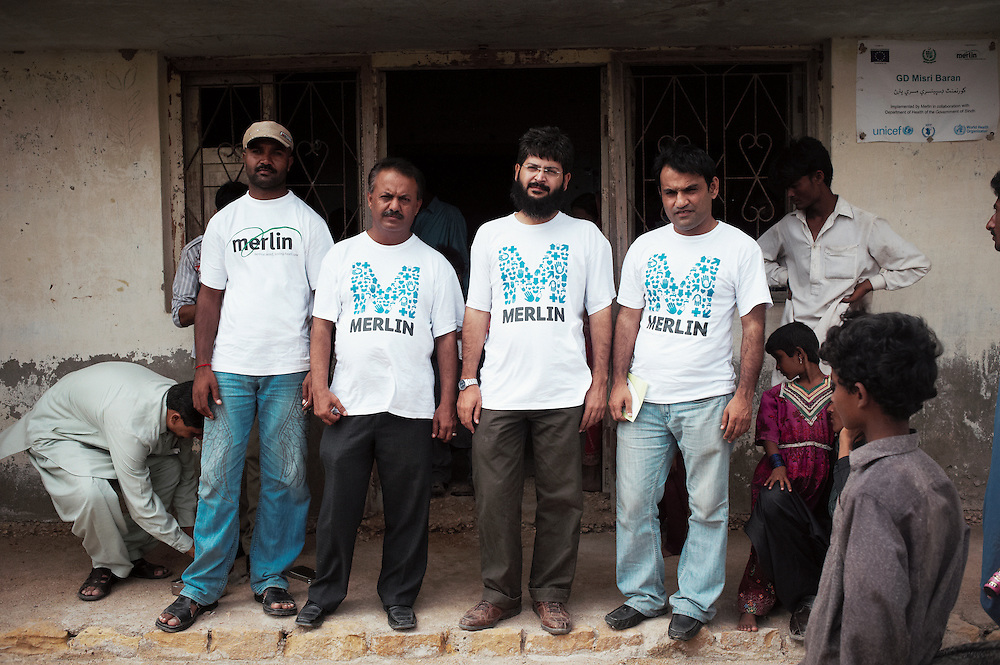 Merlin staff outside he government health clinic in the remote village of Misribaran, Thatta, Sindh, Pakistan on July 2, 2011.