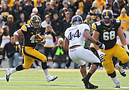 October 26 2013: Iowa Hawkeyes running back Mark Weisman (45) on a run during the first quarter of the NCAA football game between the Northwestern Wildcats and the Iowa Hawkeyes at Kinnick Stadium in Iowa City, Iowa on October 26, 2013.