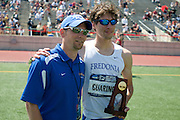2011/05/28 - SUNY Fredonia's Nick Guarino (right) poses with Head Coach Tom Wilson after the 800-meter run, which Guarino won in 1:49.89. Guarino had already won the 1500-meter run eighty minutes earlier, making him the first Division-3 runner to win both events since Nick Symmonds in 2006.