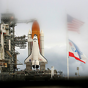 The view from the media bus as the Shuttle Atlantis rests atop the launch pad at Kennedy Space Center Thursday, July 7, 2011, in Cape Canaveral, Fla. Shuttle Atlantis is scheduled to launch on Friday, July 8 and is the 135th and final space shuttle launch for NASA..  (AP Photo/Alex Menendez)