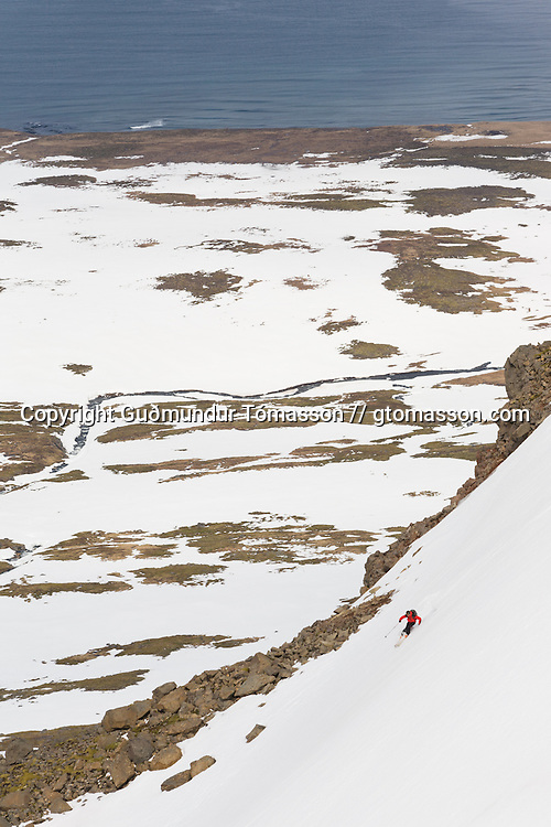 J&ouml;kull Bergmann, Ski guide, skiing in Hl&ouml;&eth;uv&iacute;k, Iceland.<br /> <br /> Images from an ski touring adventure to J&ouml;kulfir&eth;ir, a series of fjords in west Iceland, with Bergmenn Mountain Guides and Borea Adventures. The tour takes skiers from fjord to fjord with the sail boat Aurora as a overnight base.