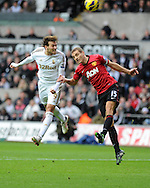 Swansea city's Michu (l) gets in a header past Nemanja Vidic of Man Utd. Barclays premier league, Swansea city v Manchester Utd at the Liberty stadium in Swansea, South Wales on Sunday 23rd Dec 2012. pic by Andrew Orchard, Andrew Orchard sports photography,