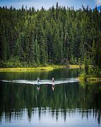Paddleboarders take advantage of a calm day on Long Lake in Whitehorse, Yukon.