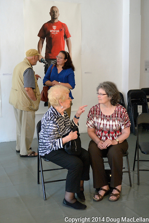 Windsor, Canada, 2014. Four people talk after a two hour question and answer period at the annual Cuban Canadian Freindship Association Windsor meeting at Artcite Inc. The event is part of the Mayworks labour arts festival.