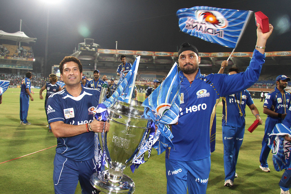 Sachin Tendulkar of Mumbai Indians and Mumbai Indians captain Harbhajan Singh celebrates after Mumbai Indians beat Royal Challengers Bangalore to win the Nokia Champions League T20 during the Final of the NOKIA Champions League T20 ( CLT20 ) between The Royal Challengers Bangalore and The Mumbai Indians held at the M. A. Chidambaram Stadium in Chennai , Tamil Nadu, India on the 9th October 2011..Photo by Shaun Roy/BCCI/SPORTZPICS