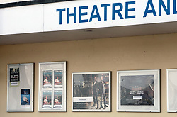 Covid 19 - Theatre and cinema in Swanage with billboards advertising showings all postponed owing to the ban on public gatherings. Dorset UK April 2020