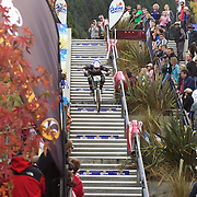 Nick McConachie from Christchurch heads down the Brecon Street steps in Queenstown during the Corona Dirtmasters Downhill event in Queenstown, Central Otago. Eighty competitors tackled the technically demanding course which started at the Gondola summit and finished with a run down the steps in Brecon Street, Queenstown. The event was part of the inaugural Queenstown Bike Festival, which took place from 16th-25th April. The event hopes to highlight Queenstown's growing profile as one of the three leading biking centres in the world. Queenstown, Central Otago, New Zealand. 24th April 2011. Photo Tim Clayton..