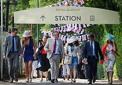 © Licensed to London News Pictures. 21/06/2018. London, UK. Racegoers arrive for Day at Royal Ascot at Ascot racecourse in Berkshire, on June 21, 2018. The 5 day showcase event, which is one of the highlights of the racing calendar, has been held at the famous Berkshire course since 1711 and tradition is a hallmark of the meeting. Top hats and tails remain compulsory in parts of the course. Photo credit: Ben Cawthra/LNP