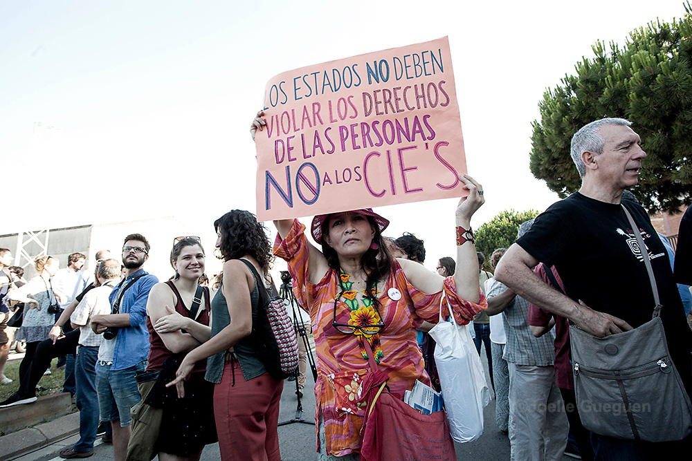 """A protester stands with a cartel saying """"The governments mustn't violate humans rights. NO to CIES"""" during the protest organized by""""Tancarem el CIE"""" to get to government to close the Immigration detention center permanently.   Barcelona 20/06/2015"""