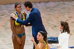 06-01-2019 NED: Dela Beach Open, Den Haag<br /> Brazil Ana Patricia Silva Ramos #1 BRA/ Rebecca Cavalcanti Barbosa Silva #2 BRA win the bronze medal / Bas van de Goor gives the gold medal Ana Patricia Silva Ramos