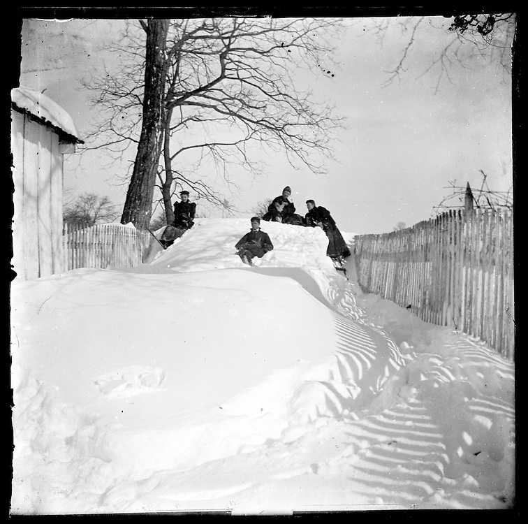 Victorian Photograph of children playing outside after a snow storm