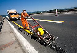Worker on the road, on June 14, 2009, at Dolgi most, Ljubljana, Slovenia. (Photo by Vid Ponikvar / Sportida)