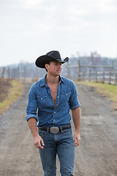 All American rugged cowboy on a dirt road