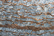 Ancient brown and blue rock pattern, Mount Robson Provincial Park, British Columbia, Canada. This is part of the Canadian Rocky Mountain Parks World Heritage Site honored by UNESCO in 1984.