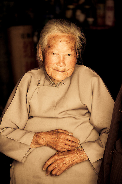 portrait of an old chinese woman smiling