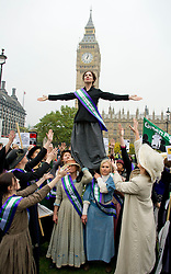 "UK Feminista photocall. 'Suffragettes' to descend on Parliament to lobby MP's for ""urgent action"" on women's equeslity.  Demonstrators dressed as suffragettes seen on Parliament Square outside the House of Commons, Wednesday October 24, 2012. Photo By i-Images"