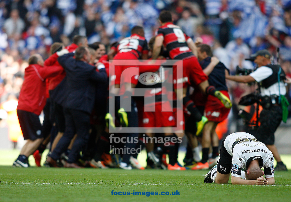 Jake Buxton of Derby County shows his dejection as the players and staff of Queens Park Rangers celebrate their victory during the Sky Bet Championship Play Off final at Wembley Stadium, London<br /> Picture by Andrew Tobin/Focus Images Ltd +44 7710 761829<br /> 24/05/2014