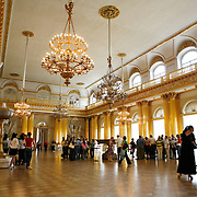 One of several grad ballroom. The Hermitage Museum also known as the Winter Palace,  was the main residence of the Russian Tsars located on the banks of the Neva River, in St. Petersburg.   Photography by Jose More