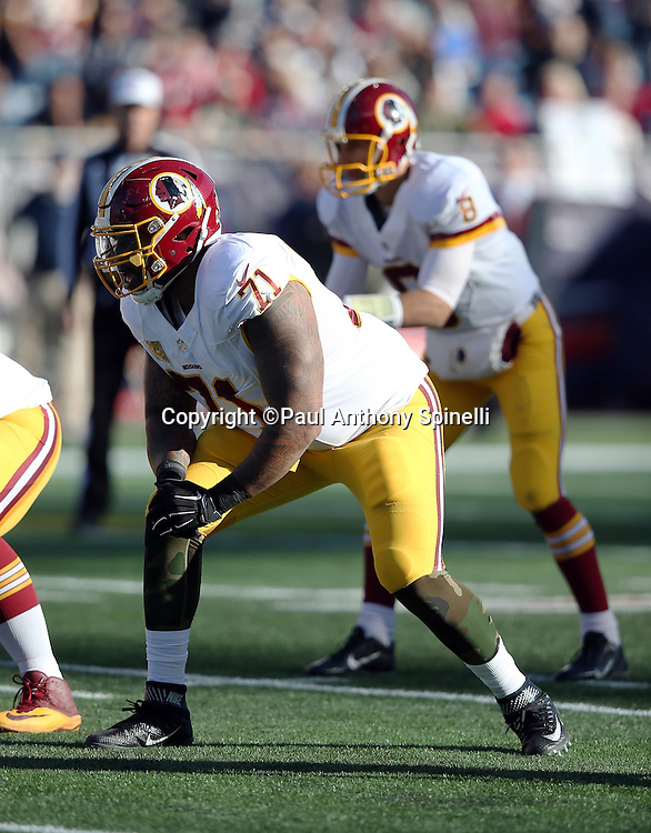 Washington Redskins tackle Trent Williams (71) gets set in a two point stance during the 2015 week 9 regular season NFL football game against the New England Patriots on Sunday, Nov. 8, 2015 in Foxborough, Mass. The Patriots won the game 27-10. (©Paul Anthony Spinelli)