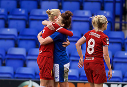 BIRKENHEAD, ENGLAND - Sunday, April 29, 2018: Liverpool's Sophie Ingle embraces her Wales international team-mate Everton's Angharad James after the FA Women's Super League 1 match between Liverpool FC Ladies and Everton FC Ladies at Prenton Park. (Pic by David Rawcliffe/Propaganda)