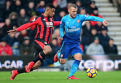 Jack Wilshere of Arsenal battles for the ball with Lys Mousset of Bournemouth - Mandatory by-line: Alex James/JMP - 14/01/2018 - FOOTBALL - Vitality Stadium - Bournemouth, England - Bournemouth v Arsenal - Premier League