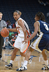 Virginia Cavaliers G Sharnee Zoll (5) dribbles around George Washington Colonials F Whitney Allen (3).  The Virginia Cavaliers women's basketball team fell to the #14 ranked George Washington Colonials 70-68 at the John Paul Jones Arena in Charlottesville, VA on November 12, 2007.