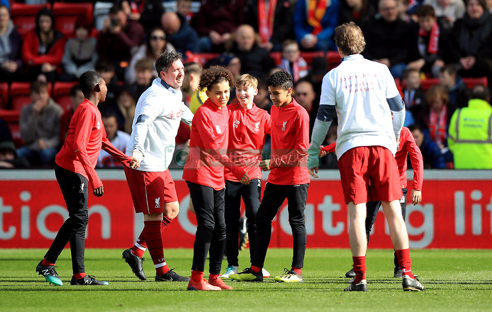 Liverpool's Robbie Fowler with the U13 players before the Legends match at Anfield Stadium, Liverpool.