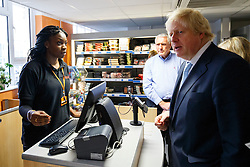 © Licensed to London News Pictures. 14/05/2015. LONDON, UK. The Mayor of London, Boris Johnson meets volunteers and staff at social supermarket the Community Shop in Gipsy Hill, south London on Thursday, 14 May 2015 to announce plans to pilot similar schemes across the capital to allow members of the public buy food reduced by up to 70 per cent of normal retail prices by selling surplus products that larger retailers can't use. Photo credit : Tolga Akmen/LNP