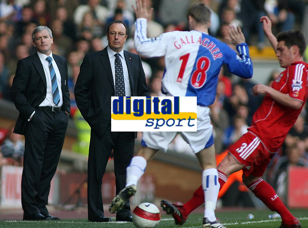 Photo: Paul Thomas.<br /> Liverpool v Blackburn Rovers. The Barclays Premiership. 14/10/2006.<br /> <br /> Mark Huges (L) Blackburn manager and Rafael Benitez, Liverpool manager watch the match.