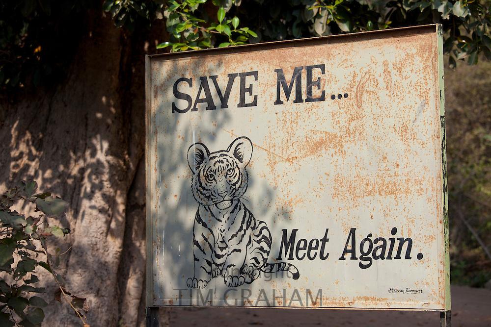 Save Tiger poster at exit of Ranthambhore National Park tiger reserve, Rajasthan, Northern India