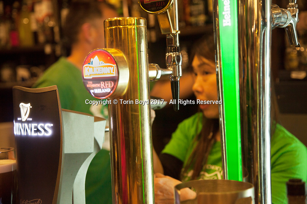 March 17, 2017, Tokyo, Japan: At all Irish pubs across the city including this one, An Solas in Tokyo's Yoyogi district, St. Patrick's Day revelers celebrated this day in full force. As Tokyo is home to a number of Irish and UK themed pubs, St. Pat's day is now embraced by the Japanese and celebrated not only in Tokyo but across the country. This is the result of years of promoting by the Irish ex-pat community, the Irish embassy, and most of all Guinness which has established a major footing within the Japanese beer market. Other events that take place in Tokyo during St. Pat's week include a big parade, Irish cultural festival and society ball. (Torin Boyd/Polaris).