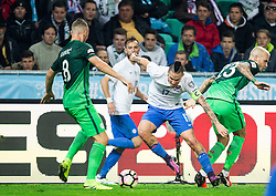 Marek Hamsik of Slovakia between Jasmin Kurtic of Slovenia and Aljaz Struna of Slovenia during football match between National teams of Slovenia and Slovakia in Round #2 of FIFA World Cup Russia 2018 qualifications in Group F, on October 8, 2016 in SRC Stozice, Ljubljana, Slovenia. Photo by Vid Ponikvar / Sportida