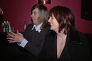 Cosey Fanni Tutti,( Christine Newby) with her son Nick.  Tate Triennial 2006 after party. Storm. Leicester Sq. London. 28 February 2006.  ONE TIME USE ONLY - DO NOT ARCHIVE  © Copyright Photograph by Dafydd Jones 66 Stockwell Park Rd. London SW9 0DA Tel 020 7733 0108 www.dafjones.com