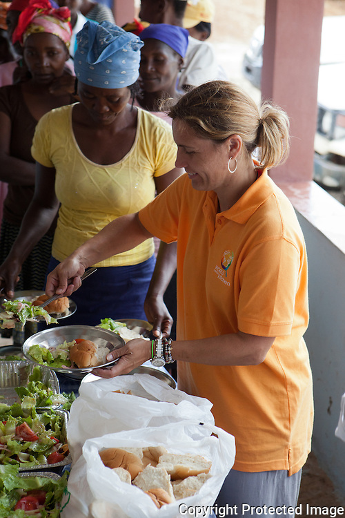 community members in palmiste tempe wait for lunch prepared by local women and chef jos andrs - World Central Kitchen
