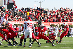 15 October 2011: Brandon Venson blocks out for conversion kicker Nick Aussieker during an NCAA football game between the University of South Dakota Coyotes and the Illinois State Redbirds (ISU) at Hancock Stadium in Normal Illinois.