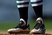 William Tribucher of the Brewster Whitecaps shows school spirit with his cleats adorned with the University of Michigan logo during game three of the Cape Cod League Championship Series against the Bourne Braves at Stony Brook Field on August 13, 2017 in Bourne, Massachusetts.