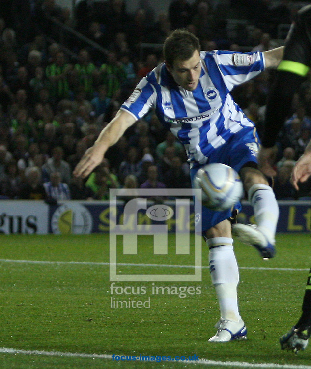 Picture by Paul Terry/Focus Images Ltd..23/9/11.Ashley Barnes of Brighton takes the first shot but puts it just wide during the Npower Championship match at The American Express Community Stadium, Brighton.