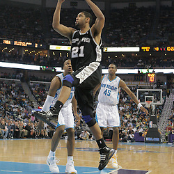 29 March 2009: San Antonio Spurs center Tim Duncan (21) drives between New Orleans Hornets defenders David West (30) and Rasual Butler (45) during a 90-86 victory by the New Orleans Hornets over Southwestern Division rivals the San Antonio Spurs at the New Orleans Arena in New Orleans, Louisiana.