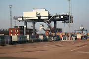 Container handling crane loader loading train, Port of Felixstowe, Suffolk, England