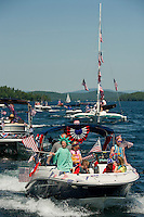 """Lady Liberty"" Anna Herrmann on board the Herrmann/Forsberg boat during the Winnipesaukee Yacht Club's 4th of July boat parade head out from Saunders Bay Monday morning.  (Karen Bobotas/for the Laconia Daily Sun)"