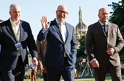 © Licensed to London News Pictures. 31/05/2017. Cambridge, UK. UKIP leader PAUL NUTTALL (centre) arrives at Senate House in Cambridge ahead of a leaders debate on BBC one. Recent polls have show a closing in the gap between the Labour Party and Conservative Party, in what was expected to be a landslide general election victory for the Conservatives. Photo credit: Peter Macdiarmid/LNP