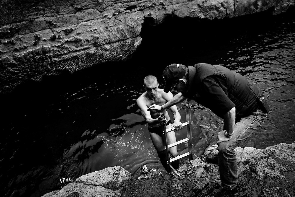 Russian high diver Artem Silchenko, exits the pool at the Serpent's Lair. The Red Bull Cliff Diving World Series 2012, Inis Mor, Ireland. 04 August 2012