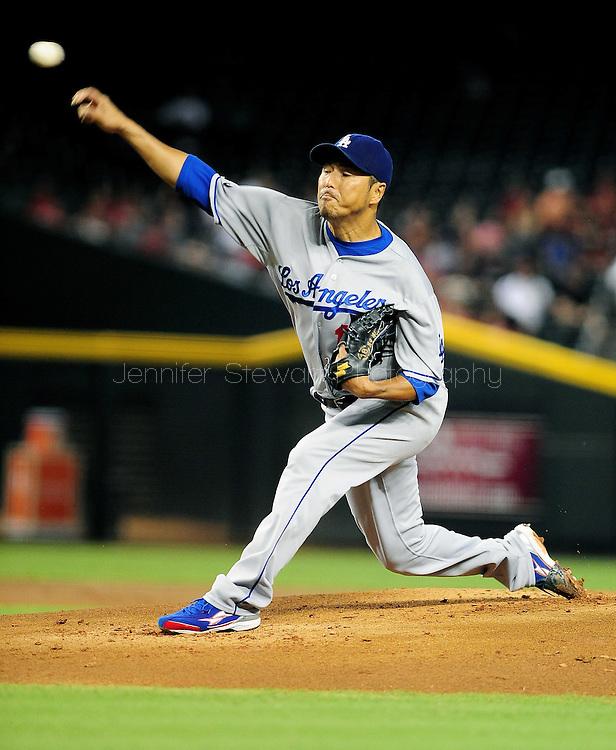 Sep. 27 2011; Phoenix, AZ, USA; Los Angeles Dodgers pitcher Hiroki Kuroda (18) delivers a pitch during the first inning against the Arizona Diamondbacks at Chase Field.  Mandatory Credit: Jennifer Stewart-US PRESSWIRE.