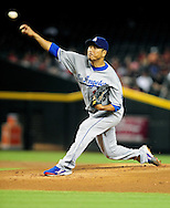 Sep. 27 2011; Phoenix, AZ, USA; Los Angeles Dodgers pitcher Hiroki Kuroda (18) delivers a pitch during the first inning against the Arizona Diamondbacks at Chase Field.  Mandatory Credit: Jennifer Stewart-US PRESSWIRE.