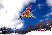 Brad Martin getting air at the US Open Snowboarding Competition at Stratton Ski Area in Vermont.